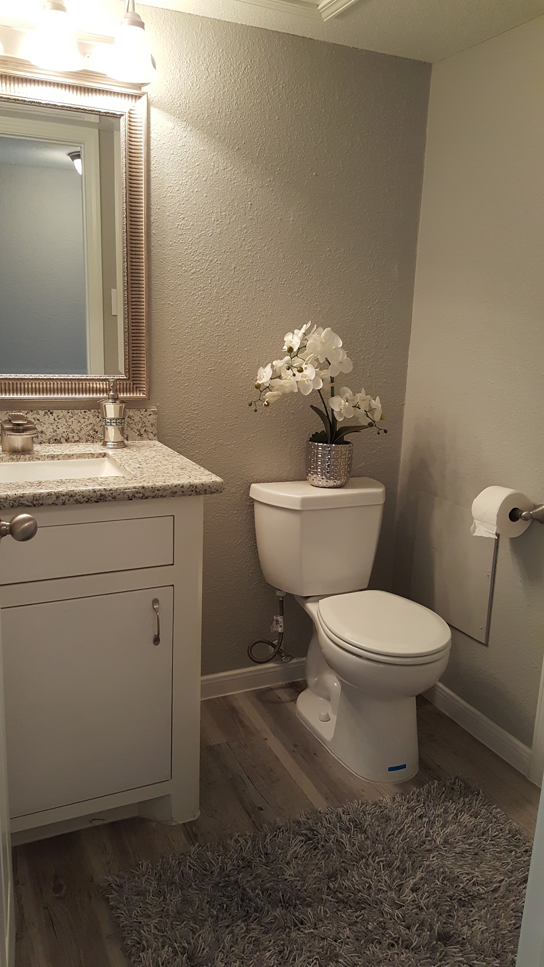 Refined Bathrooms at Grove on Gladstell Apartments in Conroe, Texas