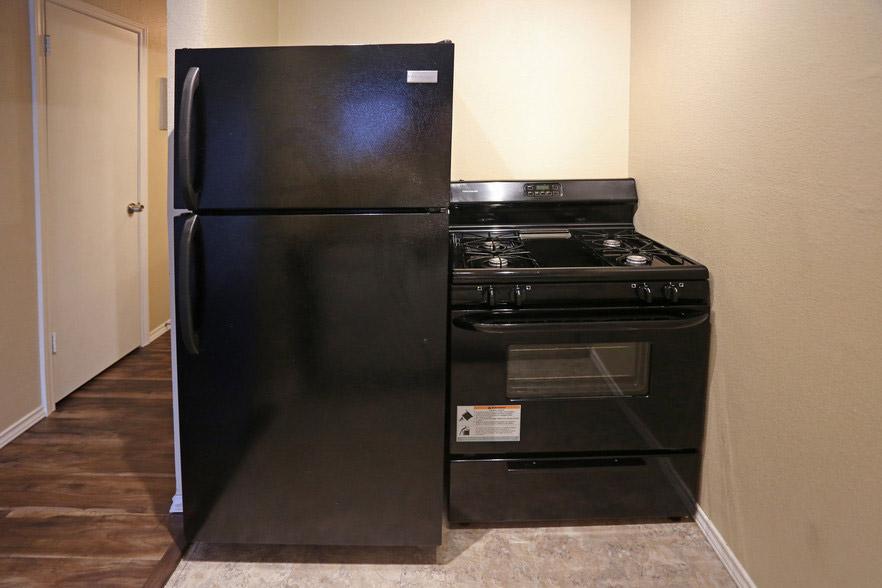 Sleek Black Appliances at Hamilton Place Apartments in San Antonio, Texas