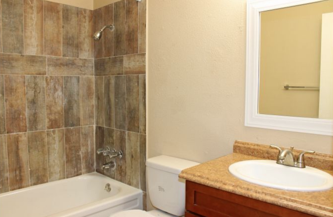 Shower and Bathtub Combination at Hamilton Place Apartments in San Antonio, Texas
