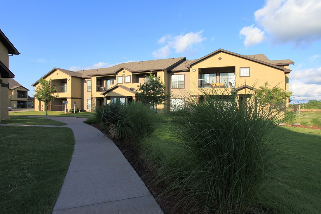 Gorgeous Landscaping at The Hamlins at Cedar Creek Apartments in Kemp, Texas