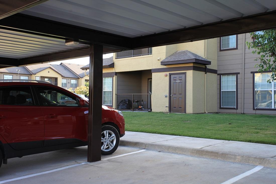 Covered Parking at The Hamlins at Cedar Creek Apartments in Kemp, Texas