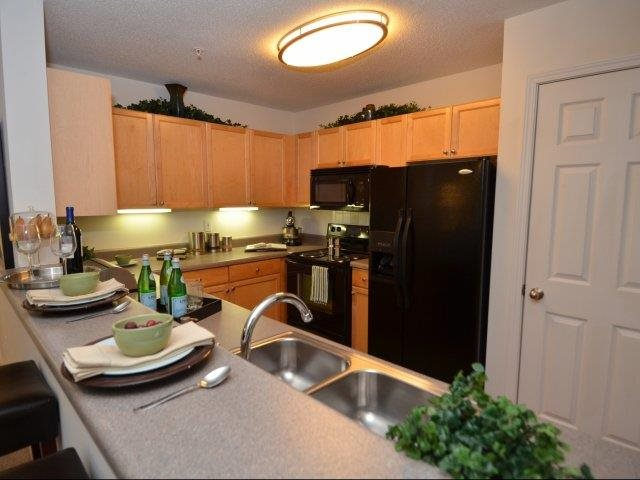 Kitchens with Breakfast Bars at The Hamptons at East Cobb Apartments in Marietta, Georgia