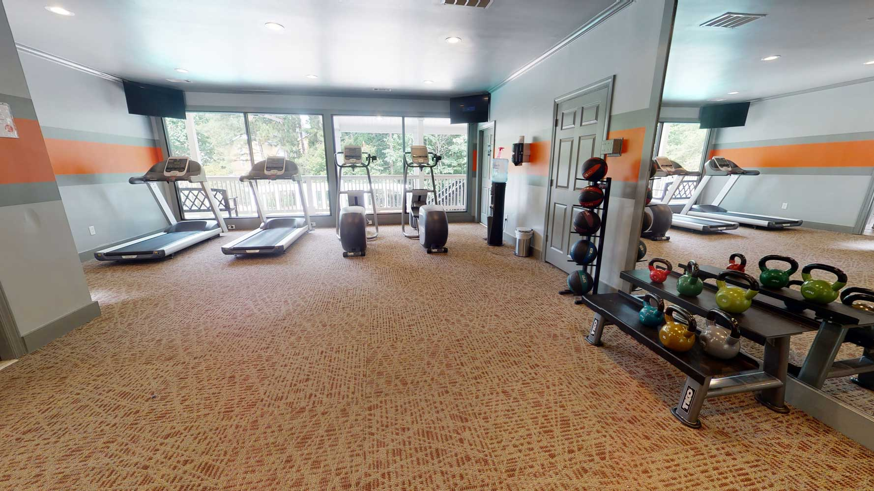 On Demand Fitness Center at The Hamptons at East Cobb Apartments in Marietta, Georgia