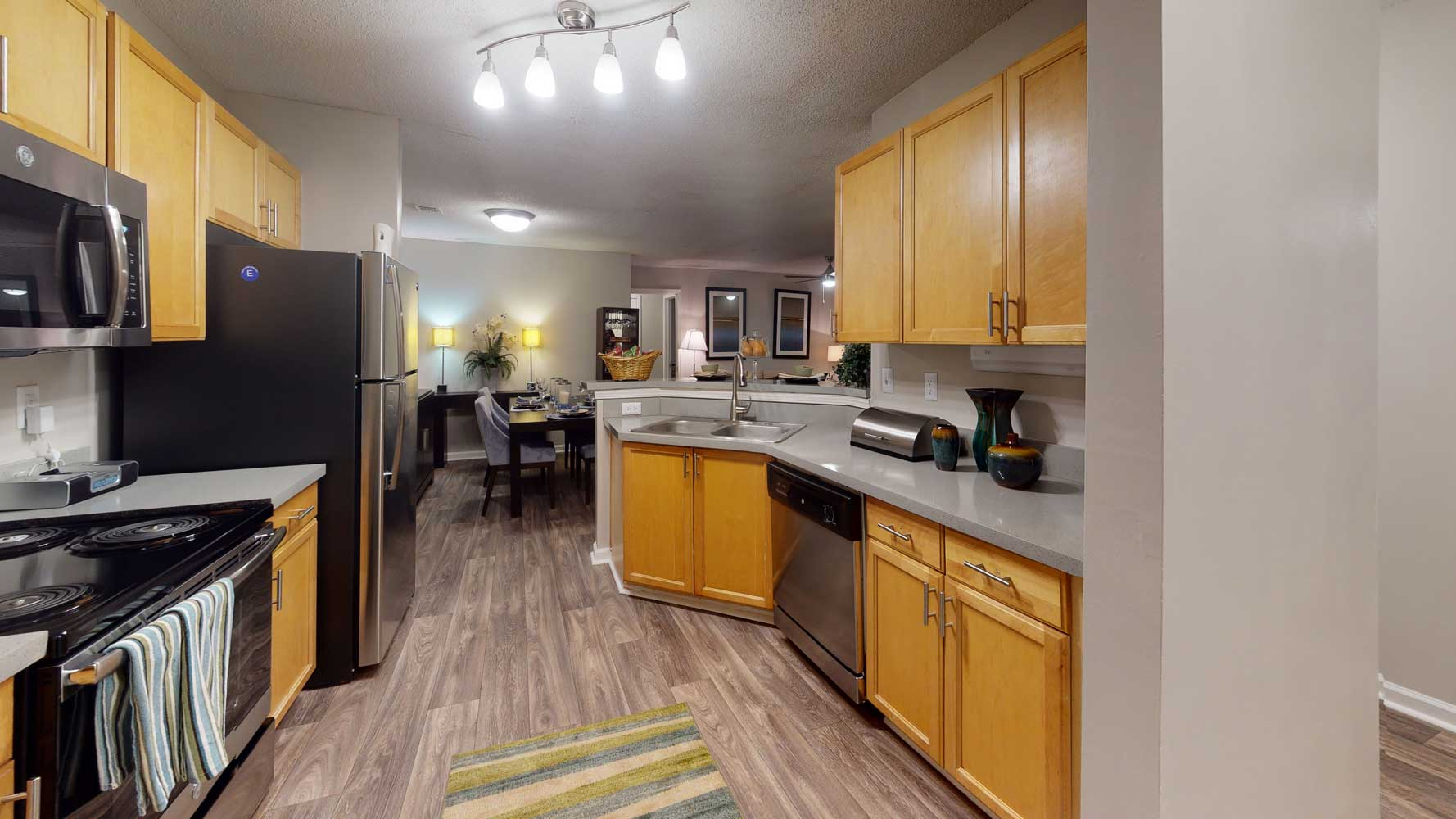 Fully Equipped Kitchen at The Hamptons at East Cobb Apartments in Marietta, Georgia
