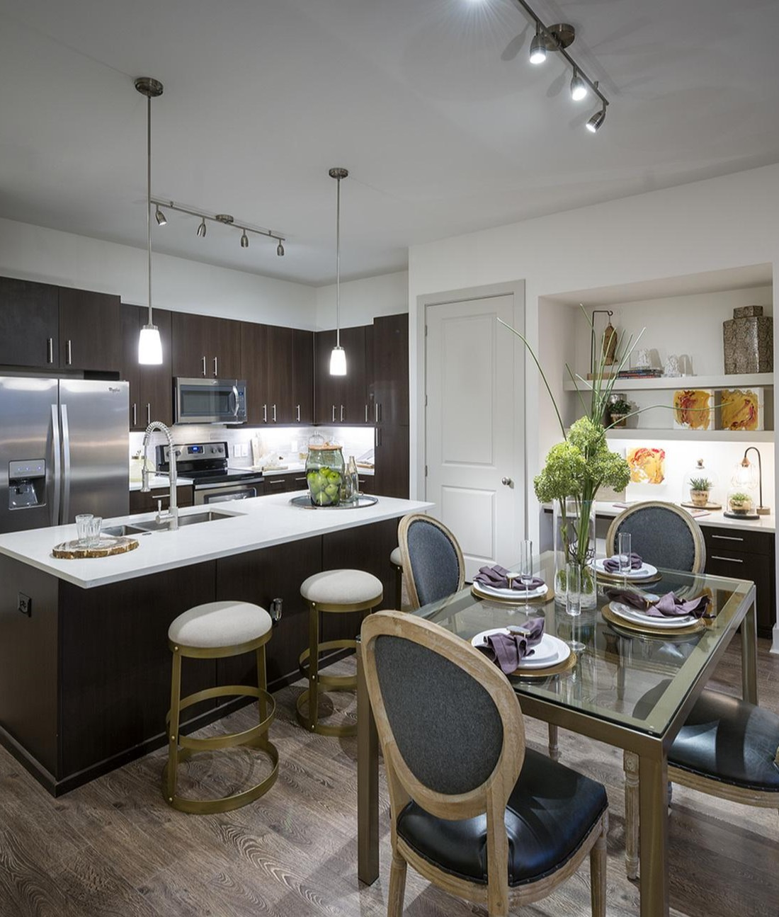 Kitchen with Backsplash Accents at Hanover West Peachtree Apartments in Atlanta, GA