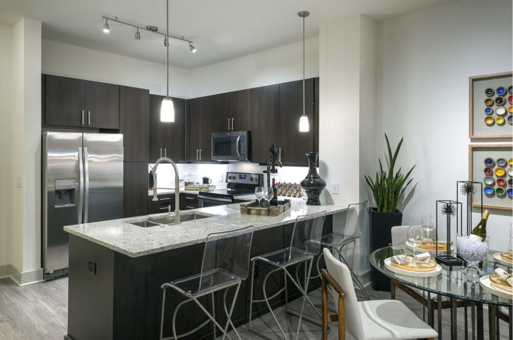 Kitchen with Stainless Steel Appliances at Hanover West Peachtree Apartments in Atlanta, GA