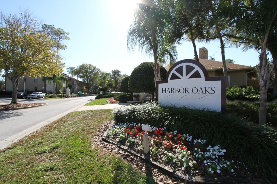 Property Sign at Harbor Oaks Apartments in Hudson, FL