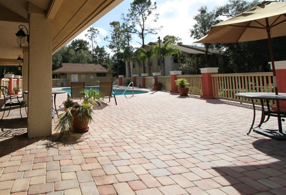 Pool Lounge Area at Harbor Oaks Apartments in Hudson, FL