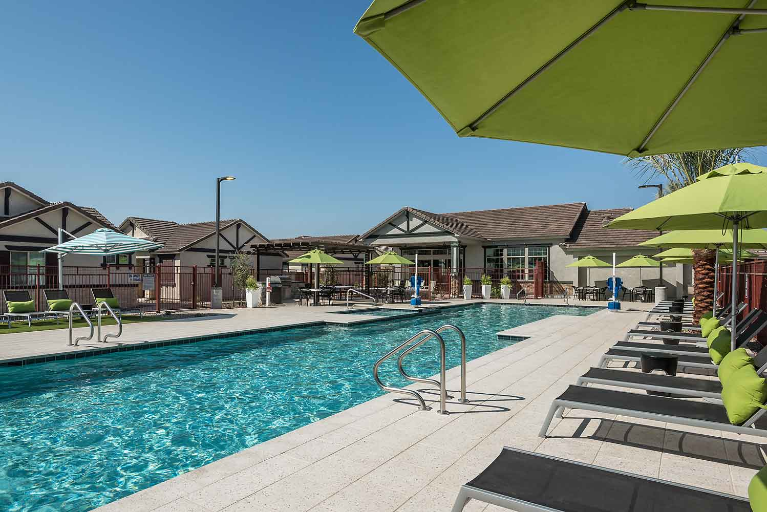 Poolside Lounge Area at Harvard Crossing Apartments in Goodyear, AZ