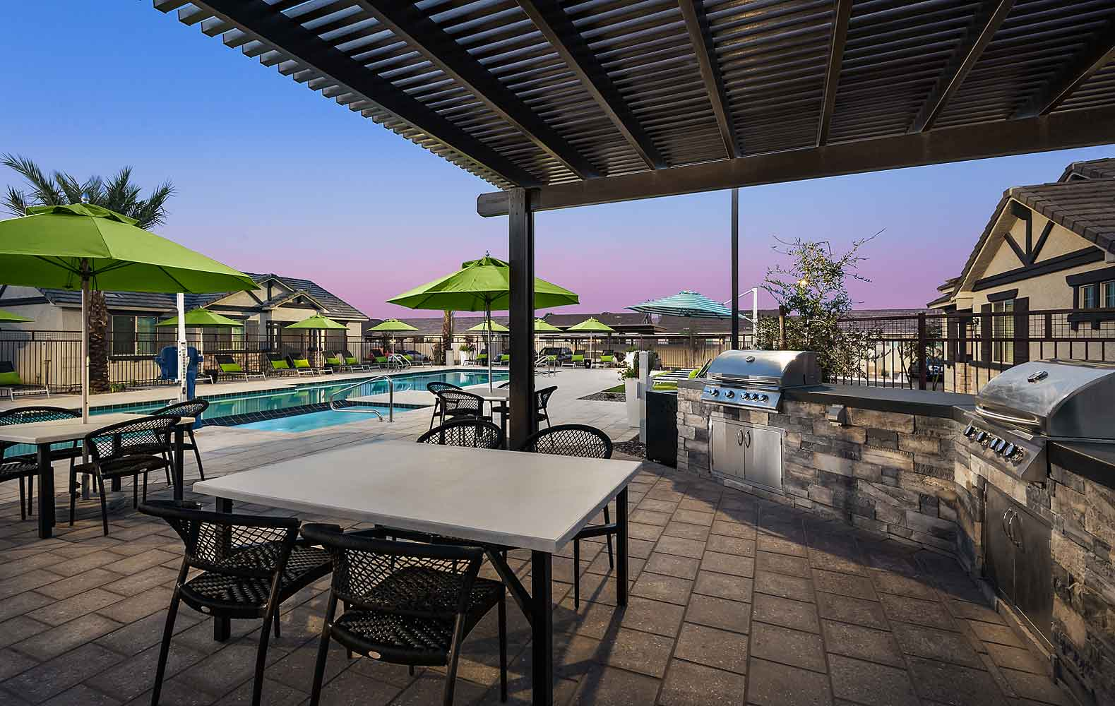 Swimming Pool and BBQ Ramada at Harvard Crossing Apartments in Goodyear, AZ