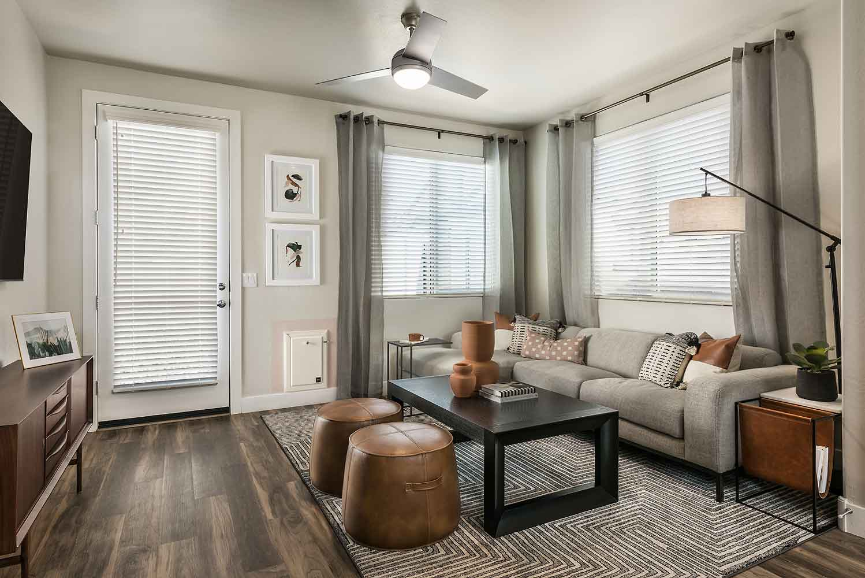 Living Room at Village at Harvard Crossing Apartments in Goodyear, AZ