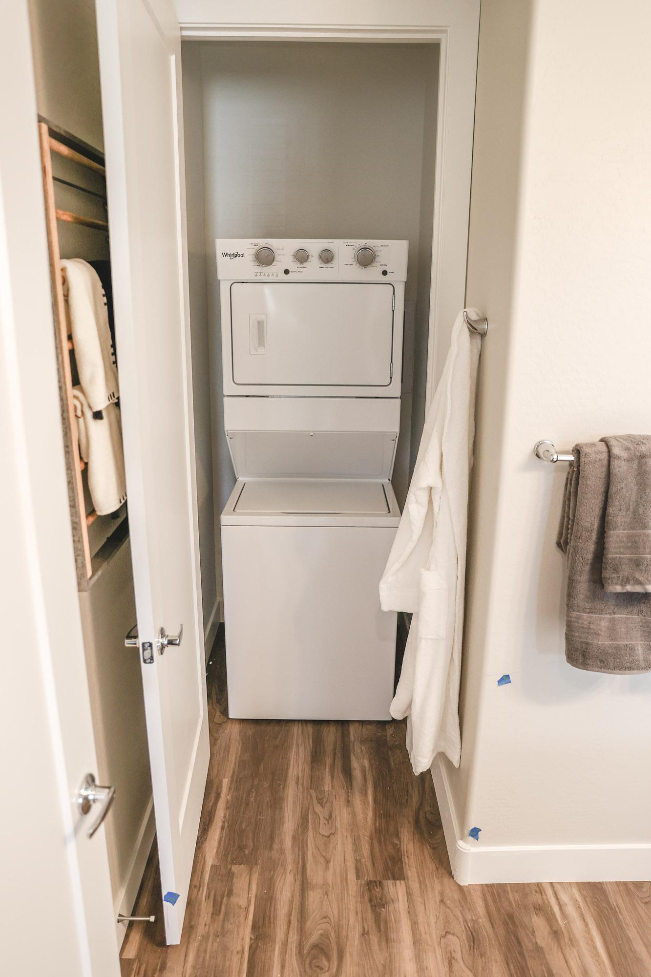Laundry Area at Village at Harvard Crossing Apartments in Goodyear, AZ