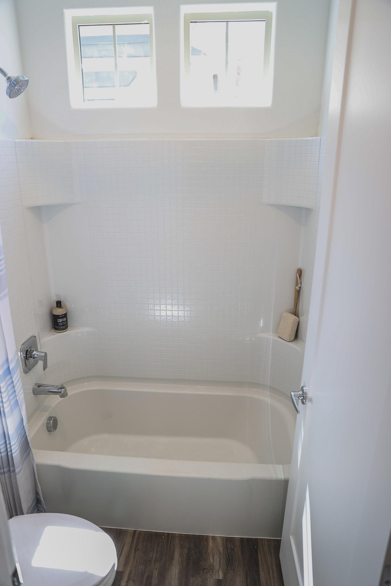 Tub and Shower Room at Village at Harvard Crossing Apartments in Goodyear, AZ