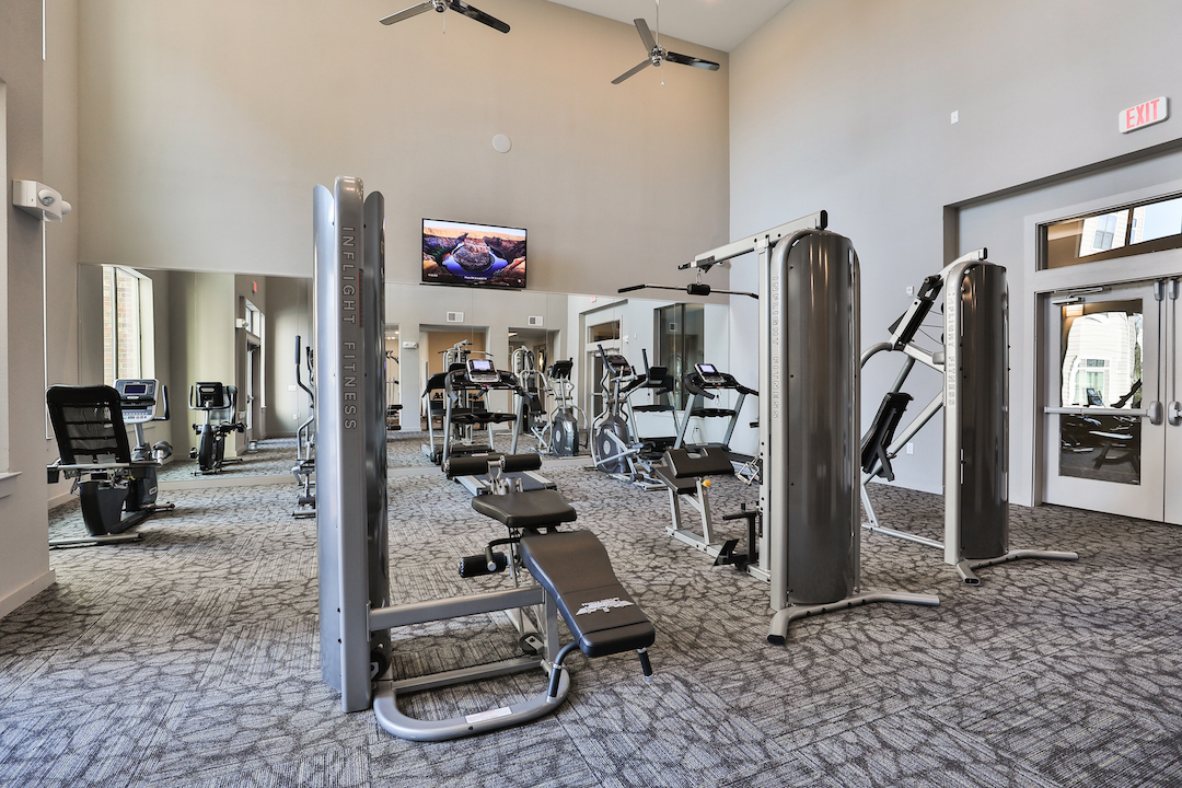 Fitness Center With Weight Equipment At Haven at Main Apartments In Houston, TX