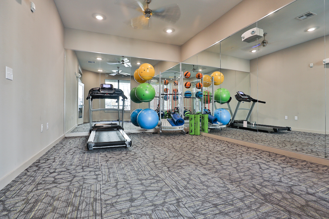 Fitness Center With Cardio Equipment At Haven at Main Apartments In Houston, TX