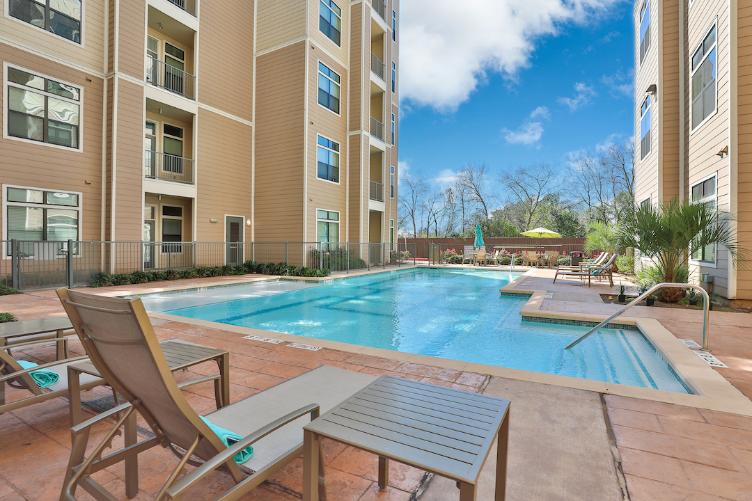 Resort-Inspired Swimming Pool & Pool Deck At Haven at Main Apartments In Houston, TX