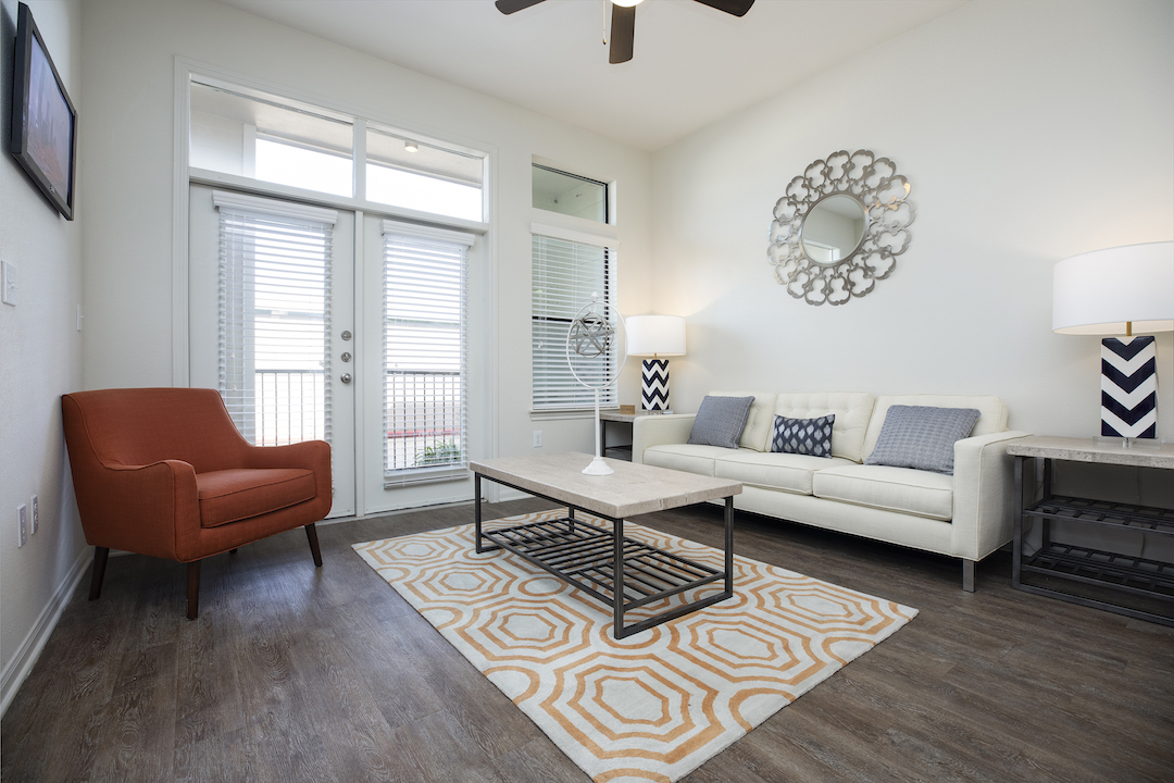 Spacious Apartment Living Rooms At Haven at Main Apartments In Houston, TX