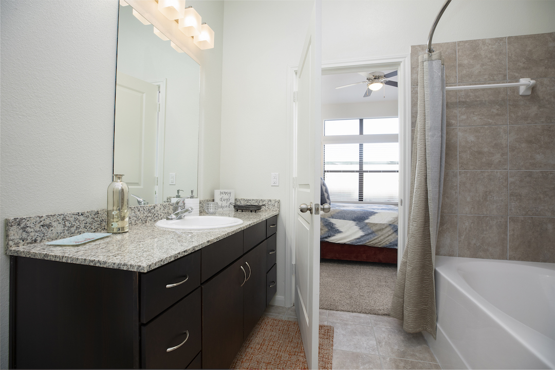 Modern Bathroom Layouts With Granite Countertops At Haven at Main Apartments In Houston, TX