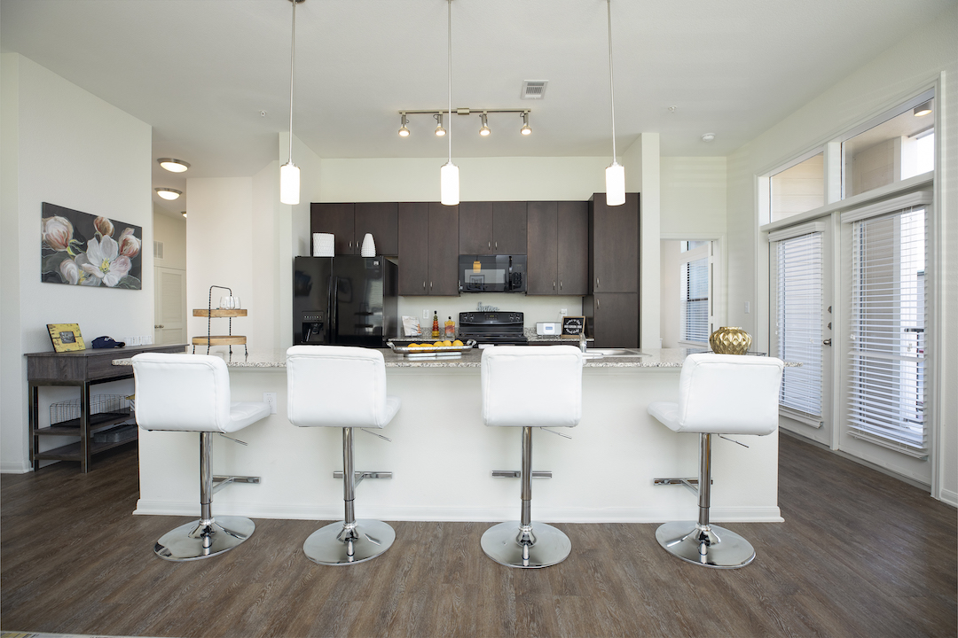 Open Concept Kitchens With Black Appliances At Haven at Main Apartments In Houston, TX