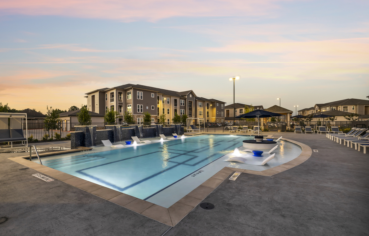 Pool Chair Lounge at Haven at Bellaire Apartments in Richmond, TX