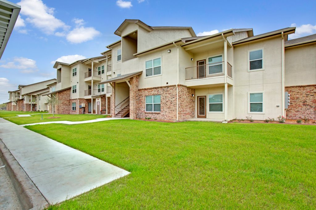 Lush Landscaping at Henderson 1575 Apartments in Los Fresnos, Texas