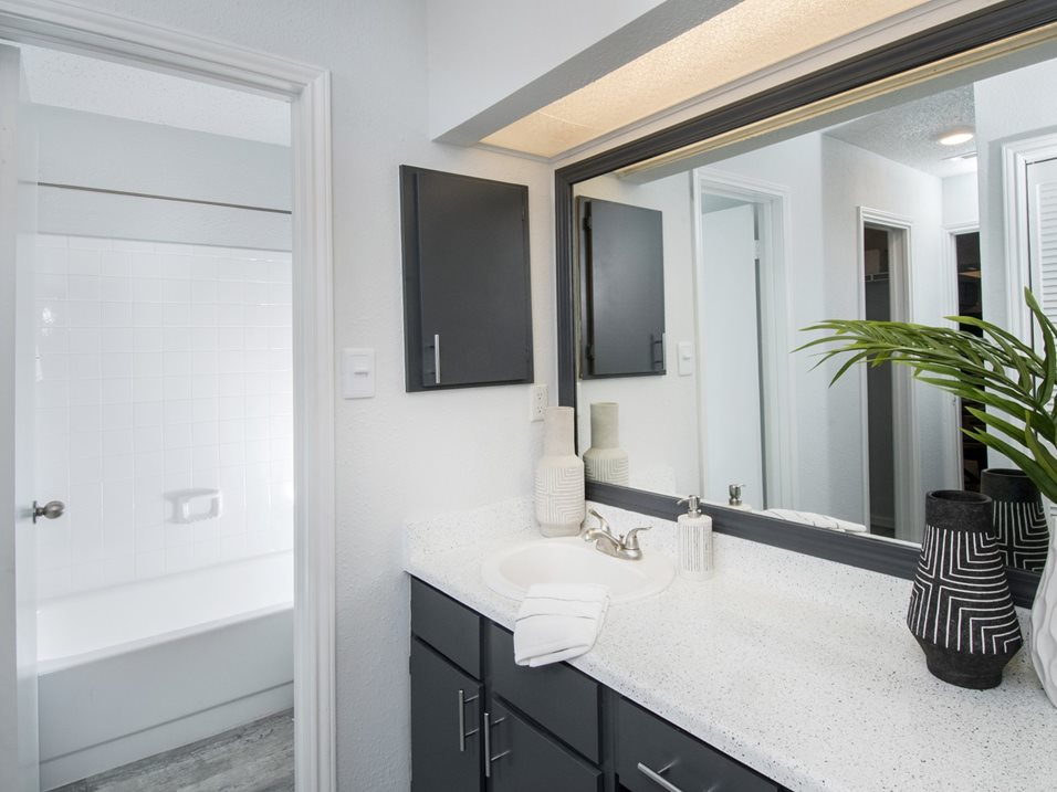 Bathroom with Large Vanity at The Henry B Apartments in San Antonio, TX
