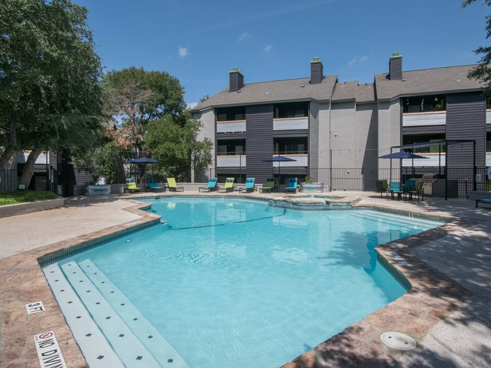 Sparkling Swimming Pool at The Henry B Apartments in San Antonio, TX