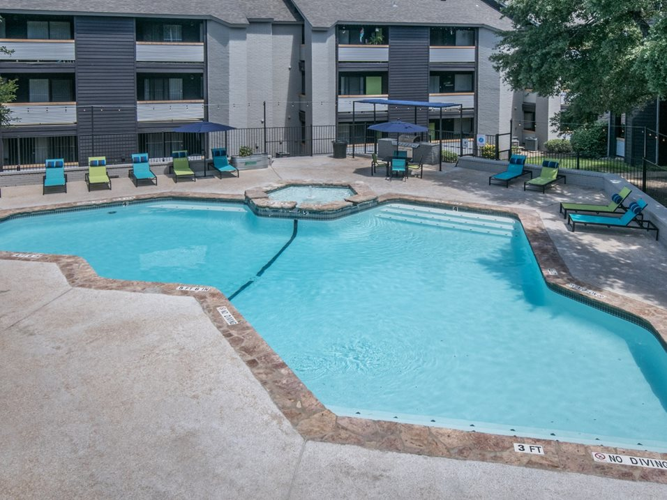 Outdoor Swimming Pool at The Henry B Apartments in San Antonio, TX