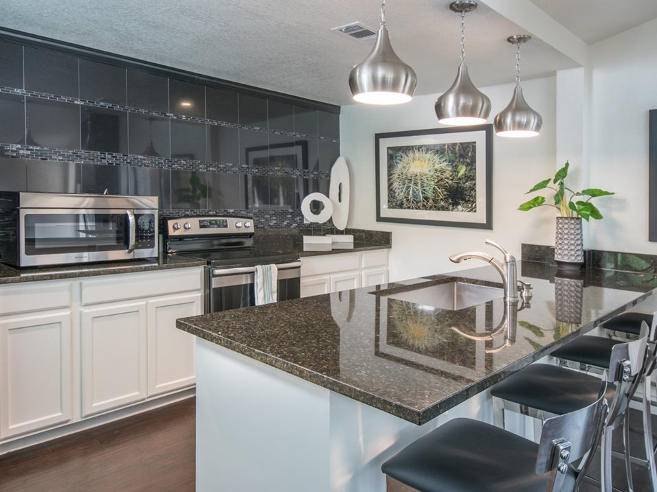 Eat-In Kitchen with Modern Lighting at The Henry B Apartments in San Antonio, TX