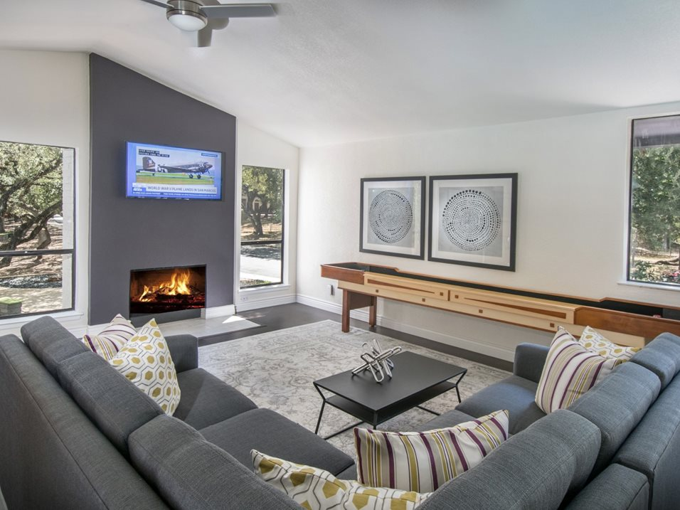 Lounge with TV and Fireplace at The Henry B Apartments in San Antonio, TX