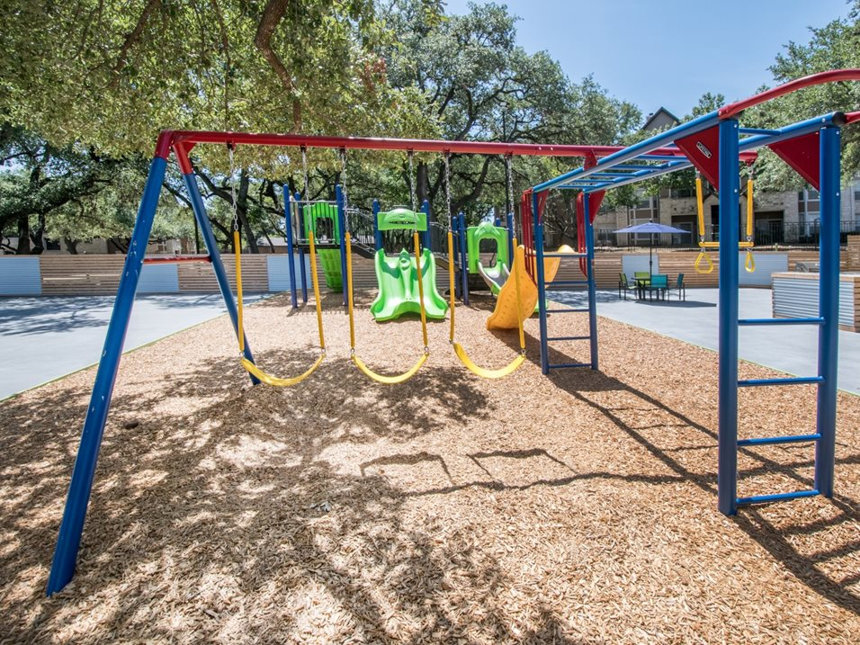 Outdoor Swing Set and Jungle Gym at The Henry B Apartments in San Antonio, TX