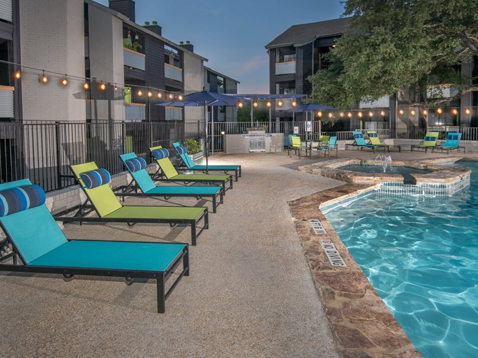 Poolside Lounge Area at The Henry B Apartments in San Antonio, TX