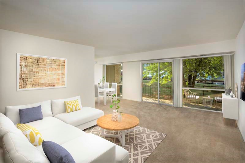 Spacious living area with a 20 ft. patio or balcony at Heritage Square Apartments