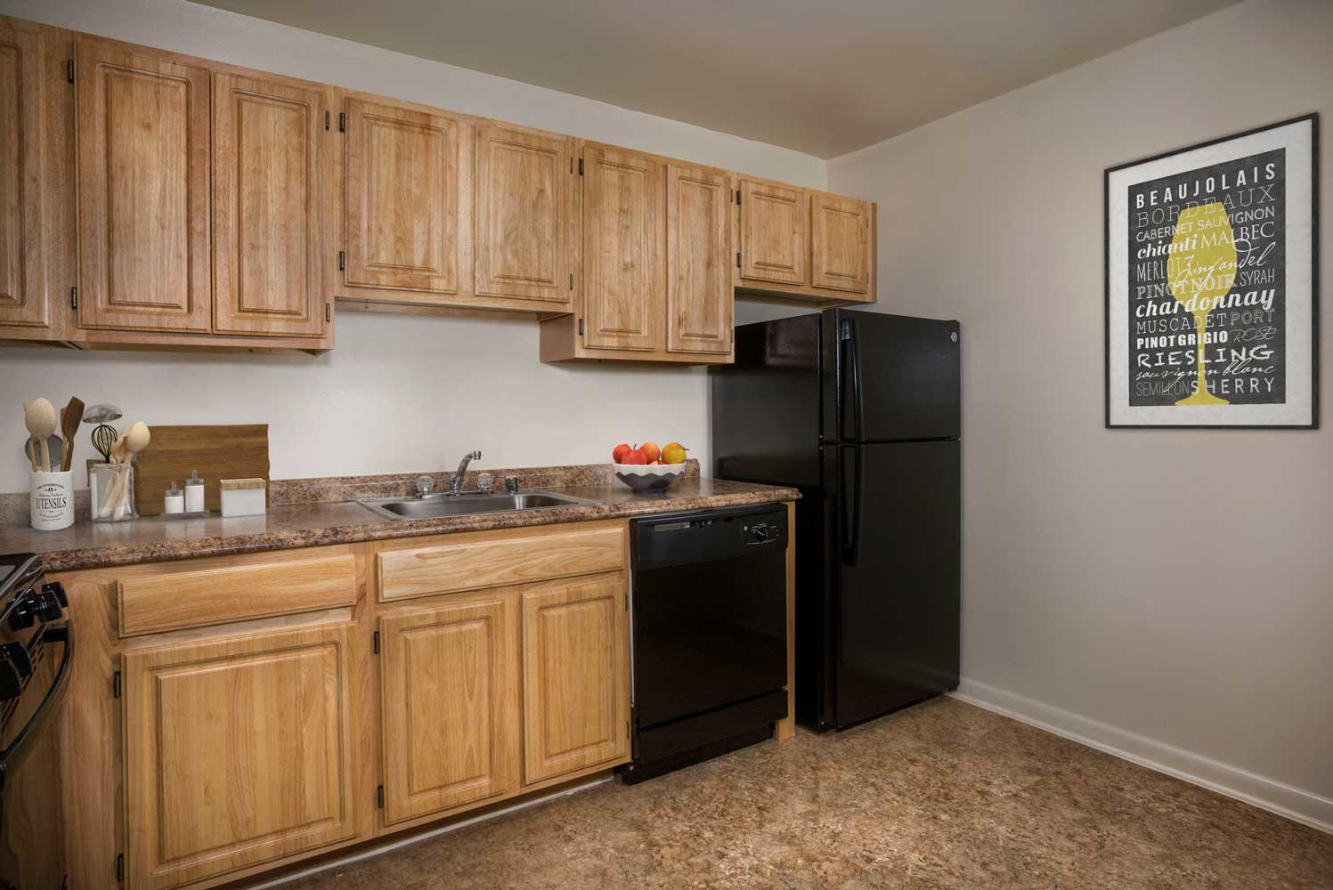 Spacious kitchen at Heritage Square Apartments (dishwasher in select homes)
