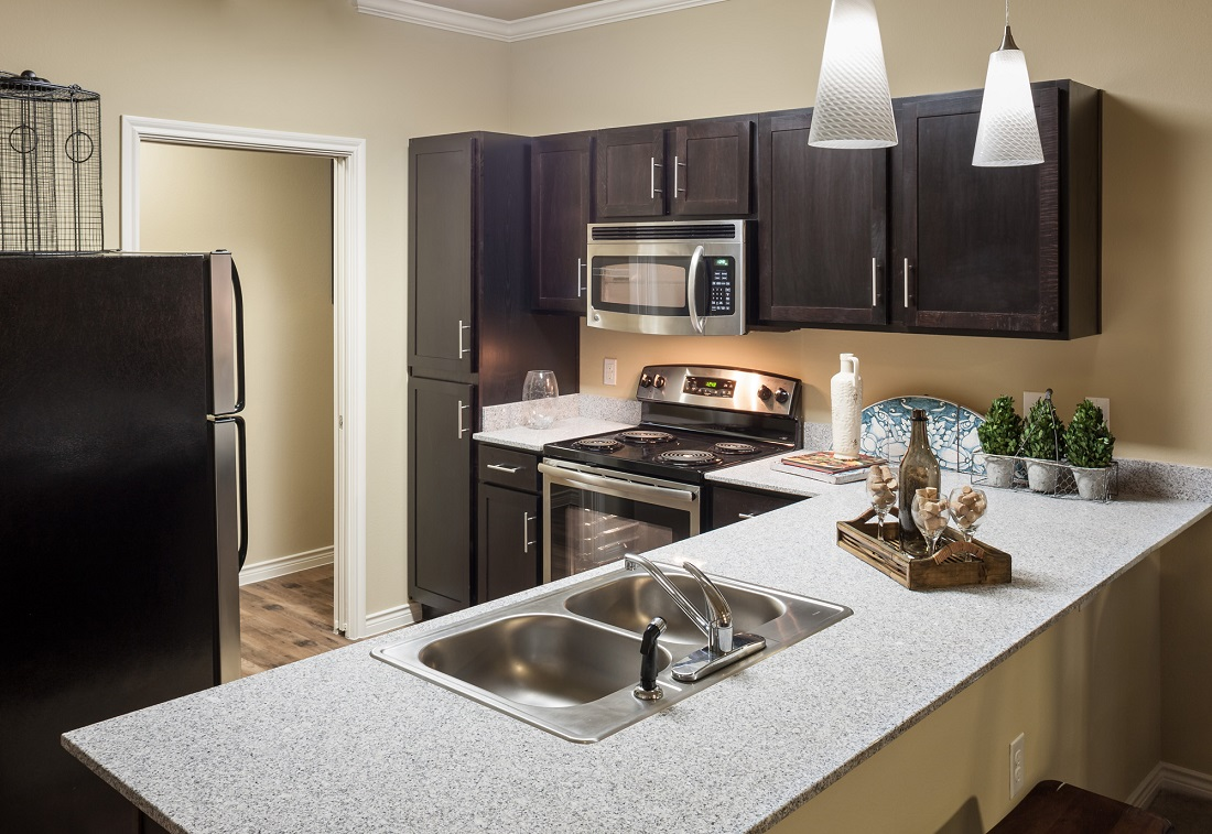 Kitchen at The Heritage Village Apartments in Hurst , TX
