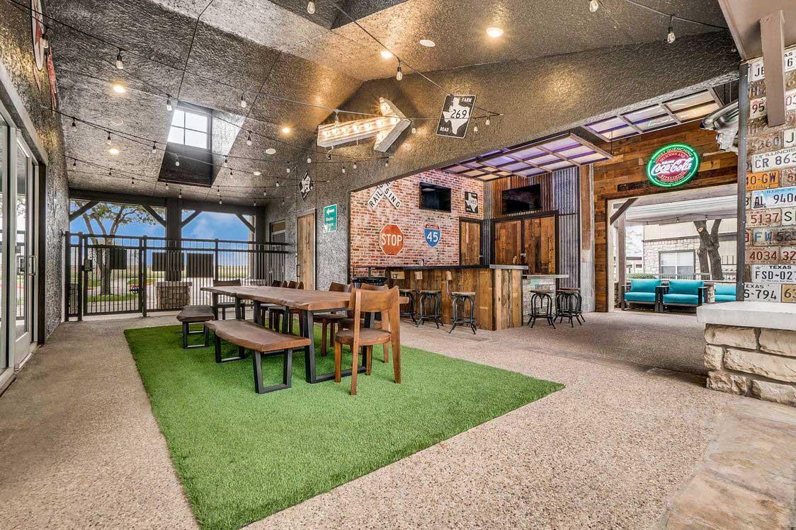 Indoor/Outdoor Social Bar at Hidden Lakes Apartments in Haltom City, Texas