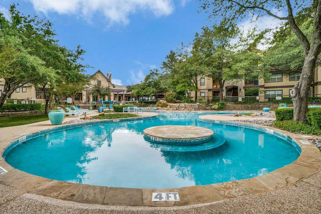 Lagoon-Style Swimming Pool at Hidden Lakes Apartments in Haltom City, Texas