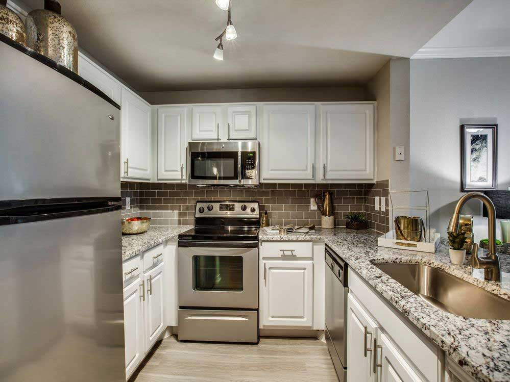 Fully Equipped Kitchen at Hidden Lakes Apartments in Haltom City, Texas