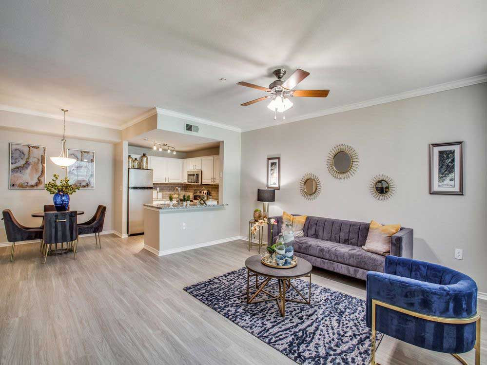 Open Floor Plan with Ceiling Fan at Hidden Lakes Apartments in Haltom City, Texas