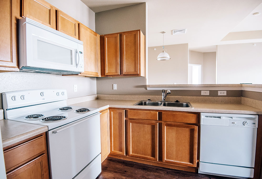 Spacious Kitchen with Appliances at Highland Ridge Apartments in Manhattan, Kansas
