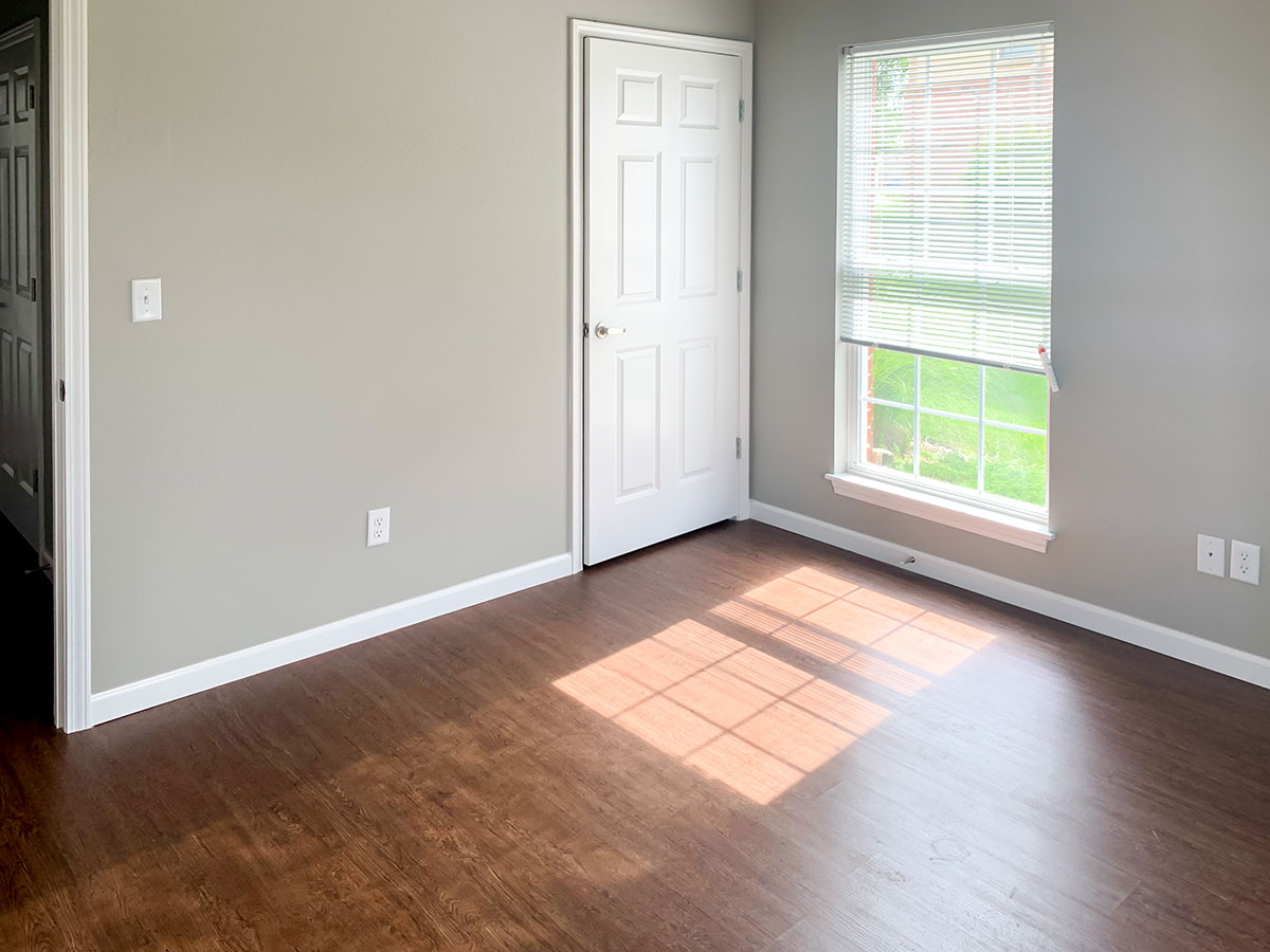 Bedroom with Plank Flooring at Highland Ridge Apartments in Manhattan, Kansas
