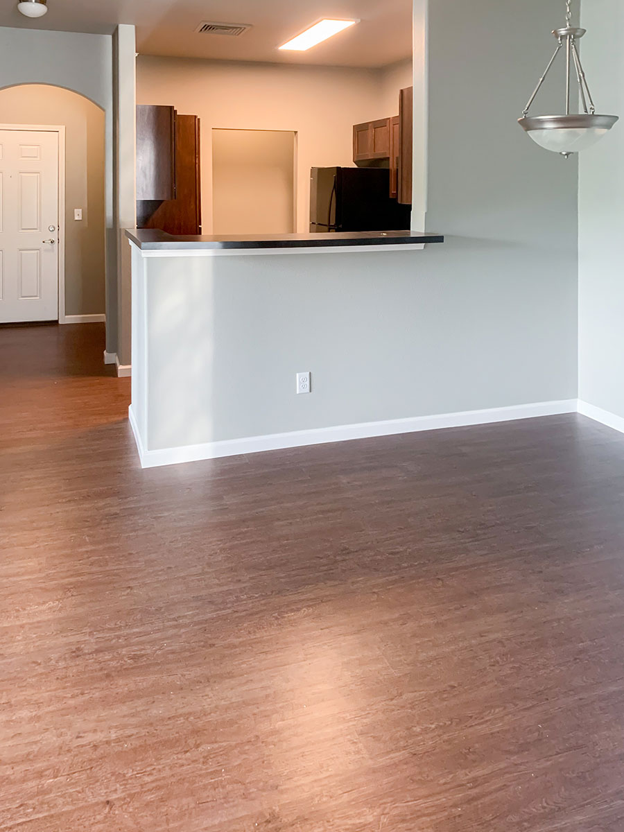 Dining Room with Plank Flooring at Highland Ridge Apartments in Manhattan, Kansas