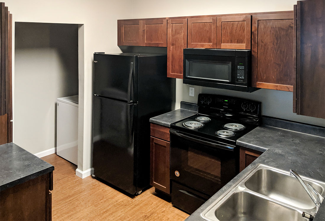 Updated Kitchens at Highland Ridge Apartments with All Black Appliances in Manhattan, Kansas
