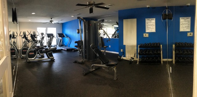Fitness center with free weights, a cable machine, and cardio equipment in Houston, TX