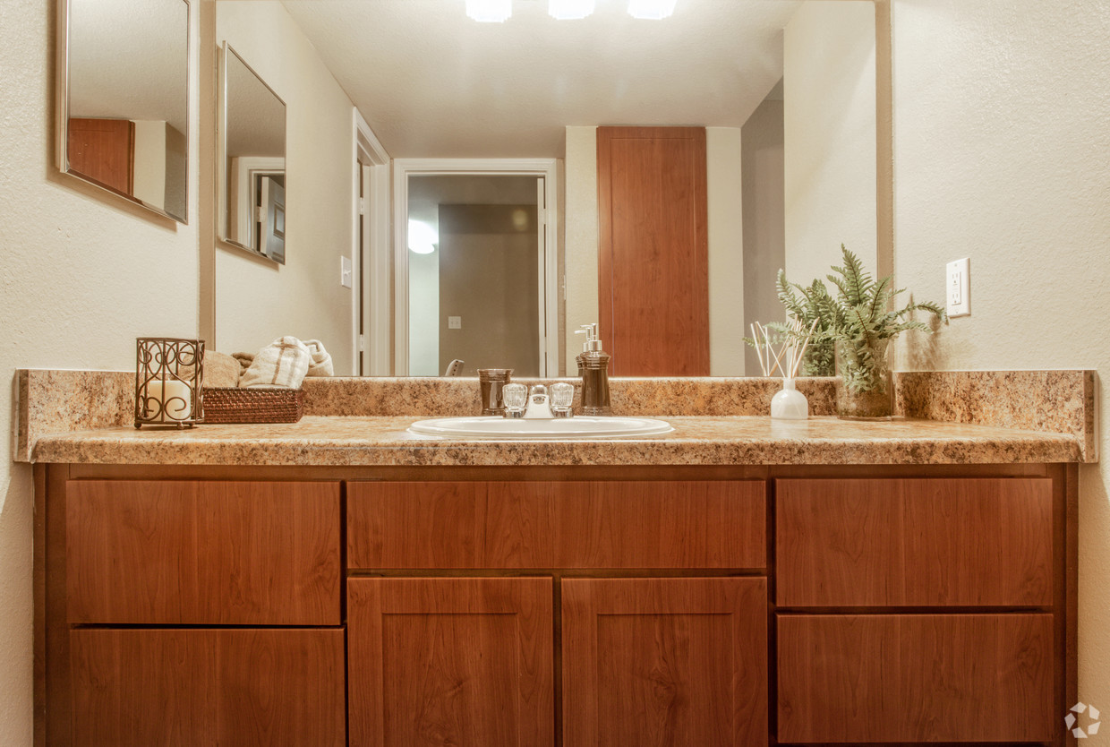 Large Bathroom with a brown vanity at Holly View Houston apartments