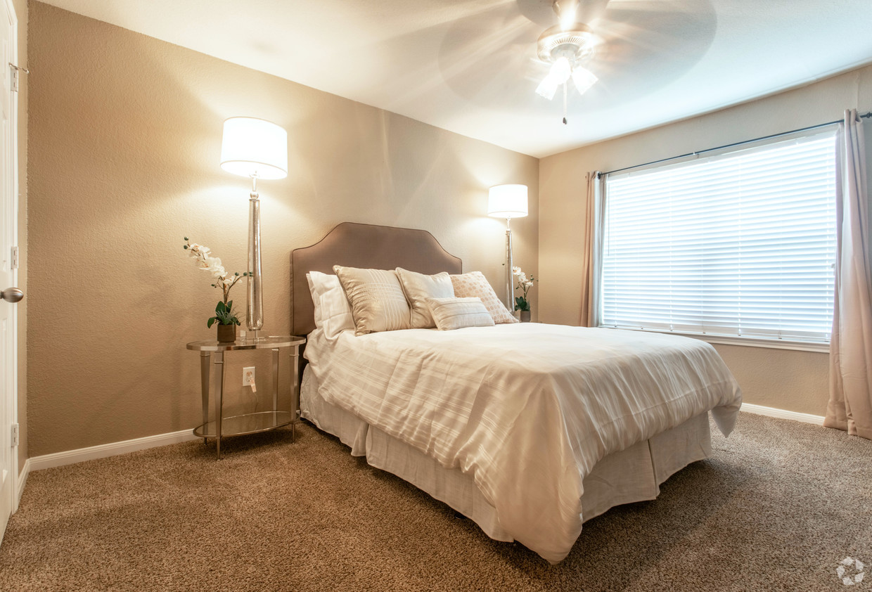 Furnished bedroom with carpet floors and natural light at Holly View apartments
