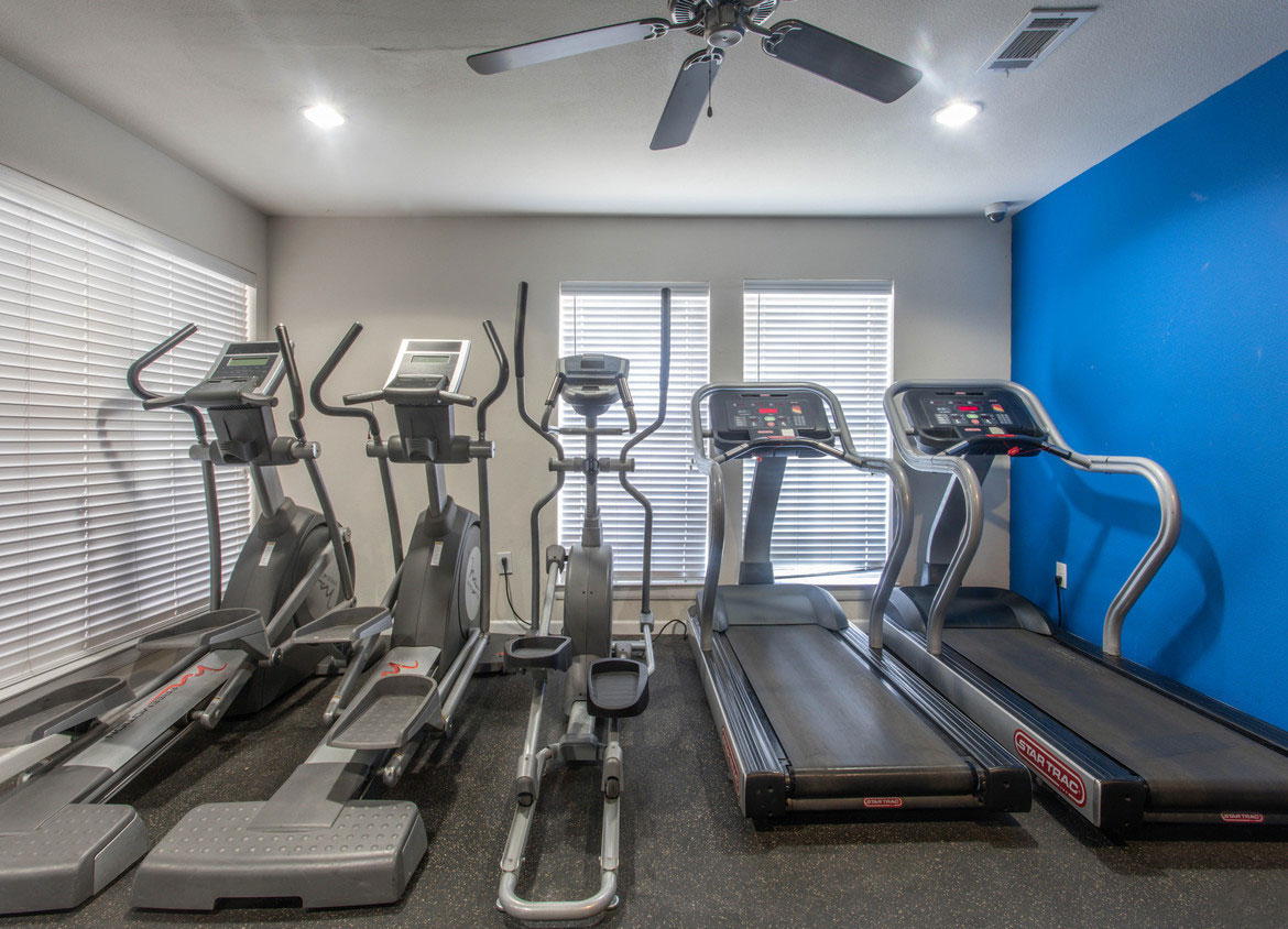 Ellipticals and Treadmills at HollyView Apartments in Houston, TX