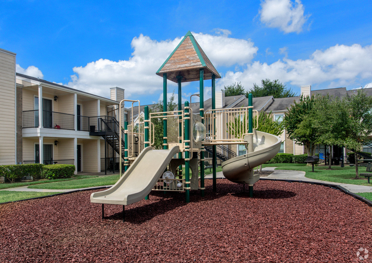 Playground at Holly View Apartments with a multi-colored jungle gym