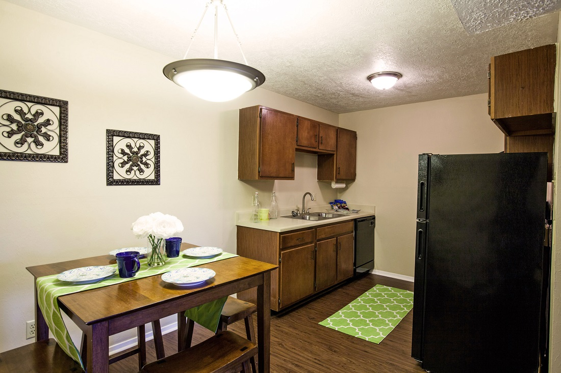 Kitchen and Dining Area at The Hunters Point Apartments in College Station, TX