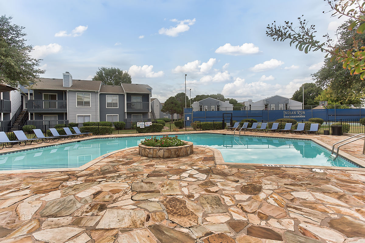Large Outdoor Swimming Pool with Seating at Indian Run Apartments in Abilene, TX